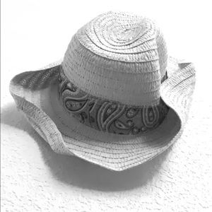 Straw hat with red patterned trim